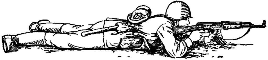 Рис. 76. Стрельба лежа с упором магазина в грунт