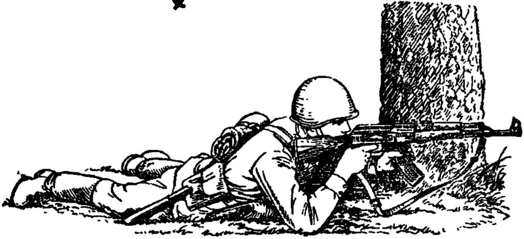 Рис. 77. Стрельба из-за укрытия лежа